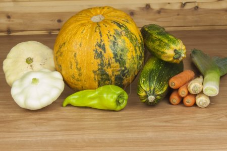 Autumn harvest vegetables. Growing organic vegetables in the country. Diet food for weight loss. Different kinds of vegetables on a wooden kitchen table. Background with vegetables.