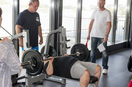 Woman athlete performing the bench press
