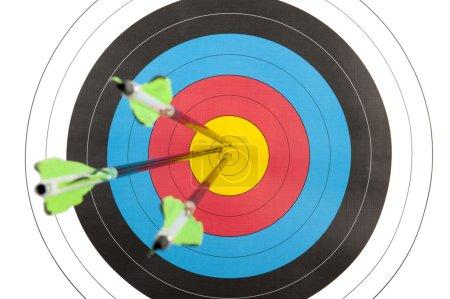 Archery target hit by three arrows