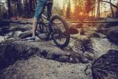 Ride on mountain bike at sunset.