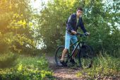 Mountain biker rides a Bicycle in the morning
