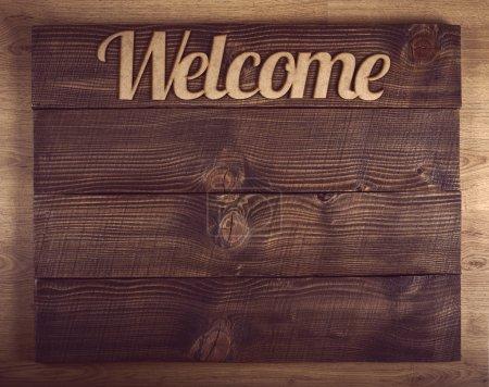 Photo pour Signe de bienvenue en bois avec l'ancien espace copie brun - image libre de droit