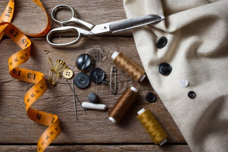 Photo for Sewing accessories scissors, needle, thimble on wooden table - Royalty Free Image