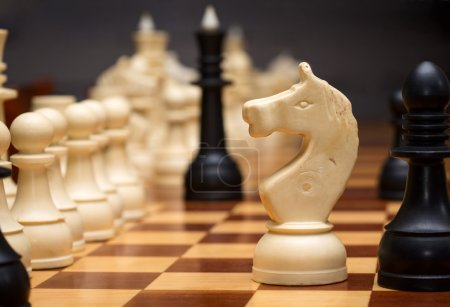 Chessboard and pieces close-up