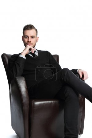 Relaxed businessman sitting down