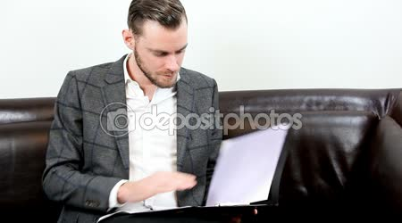Businessman opening a folder working