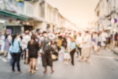 Blurred crowd of people on the street in phuket old town
