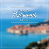 Greetings from Dubrovnik postcard with blurry image in back