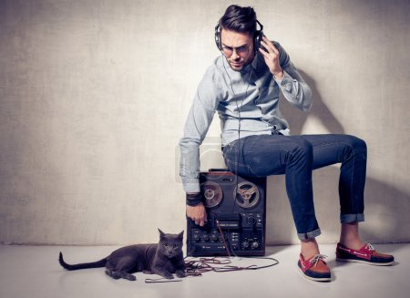 Man and cat listening to music