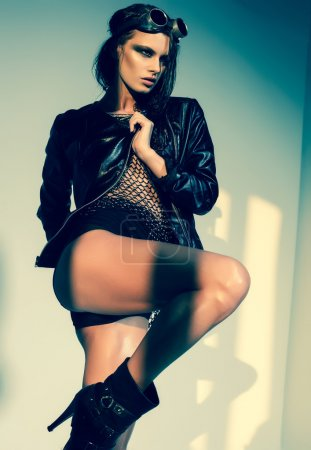 Sexy woman model dressed punk