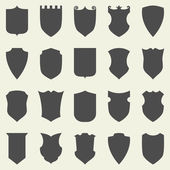 Set of blank empty dark shields Shield badge vector shapes icon