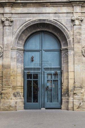 Old blue entrance gate on a beautiful church archi...