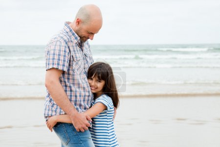 Loving father and daughter on the beach