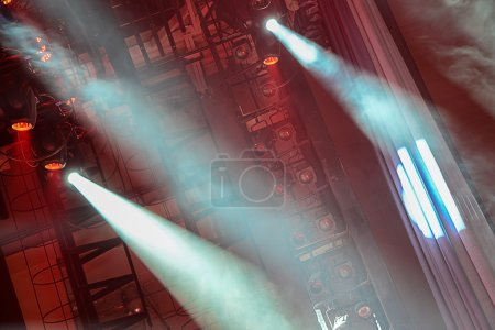 Photo for Concert spotlights shining red light and fog - Royalty Free Image