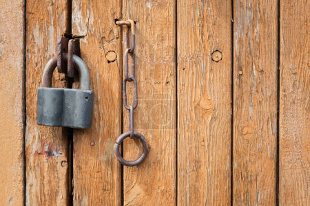 Photo for Locked old wooden door with a lock and metal chain - Royalty Free Image