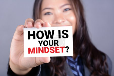 Photo for HOW IS YOUR MINDSET? message on the card shown by a woman - Royalty Free Image