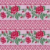 Knitted Ornamental Seamless Vector Pattern as a fabric texture with rows of stylish Red Roses and green leaves