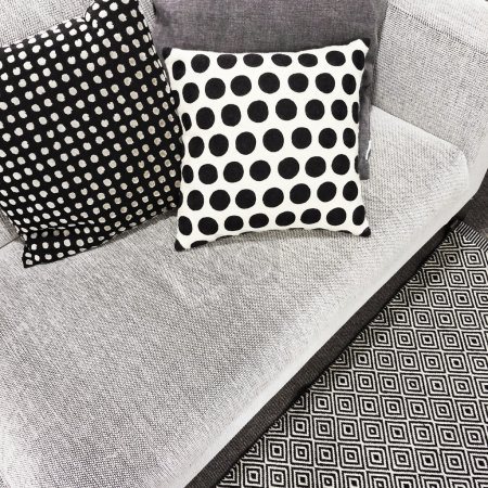 Black and white polka dot cushions on a sofa