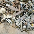 Pile of scrap metal pieces on a pile, recycling co...