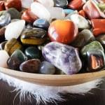 Colorful semi precious stones or gems on a bowl...