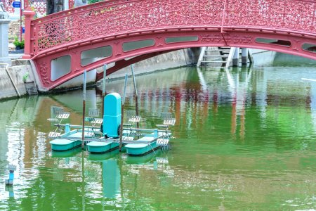 Water wheel floating on canal city.