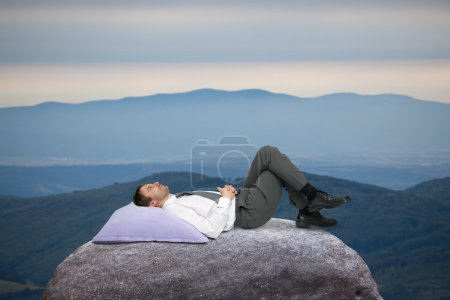 Photo for Young businessman resting after work in the countryside - Royalty Free Image