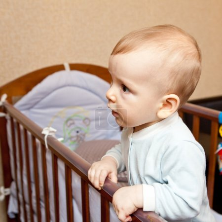 Child standing in the crib