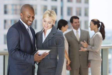 Interracial Men & Women Business Team With Tablet Computer