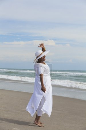 Happy Senior African American Woman Dancing on Beach