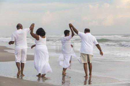Happy romantic senior African American men and wom...