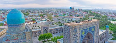 The tiled domes and mosaic portals of Registan square looks great from the minaret top, Samarkand, Uzbekistan.