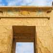 The entrance to Habu Temple decorated with the sac...