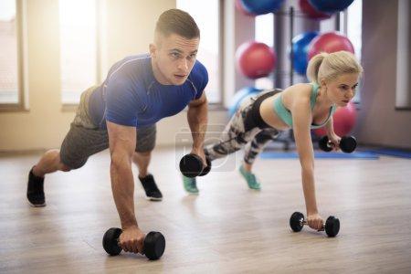 Couple making push ups
