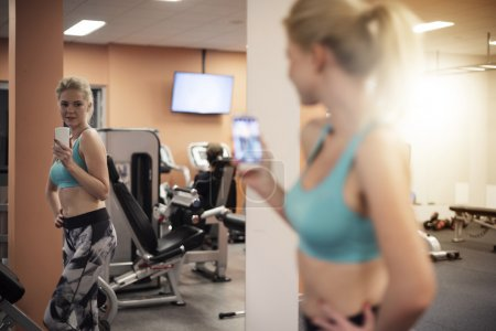 Woman taking Selfie after workout