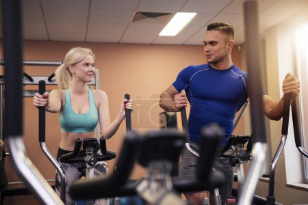 Photo for Couple working out together at the gym. Man and woman motivating each other - Royalty Free Image