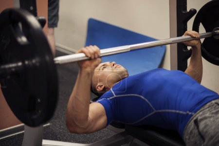 Man doing workout on weight bench