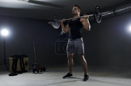 Man doing exercise with barbell