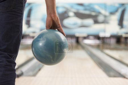 Man about to push the bowling ball