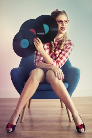 Pin up girl with vinyl records