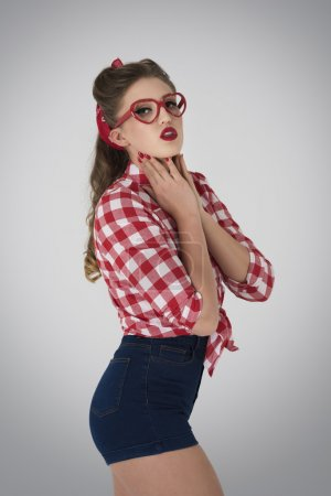 Pin up girl with red eyeglasses
