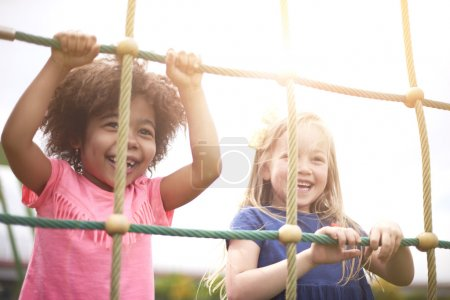 Photo for Girls playing together at playground. Playing with friend make you happier - Royalty Free Image