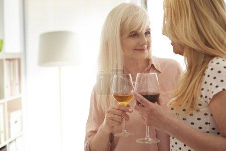 Mature women drinking their favorite wine