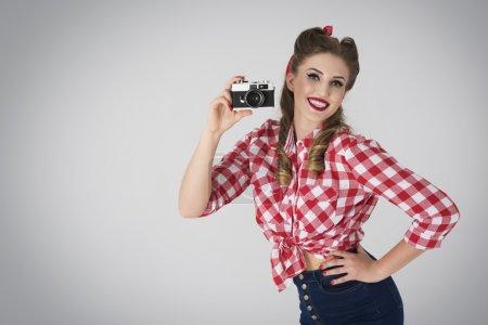 Pin up girl with retro camera