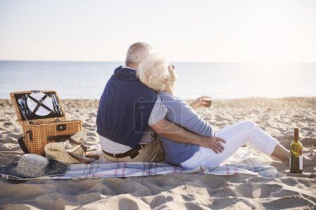 Photo for Senior marriage having good morning on the beach - Royalty Free Image