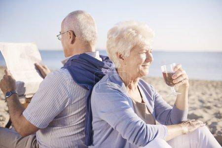 Photo for Senior couple enjoying day on the beach - Royalty Free Image