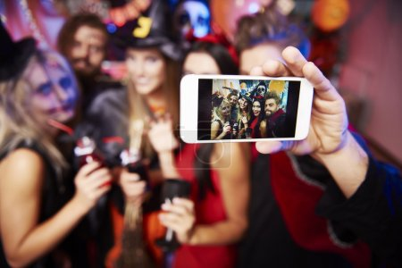 Man taking selfie of friends at party