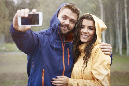 Loving couple in rain