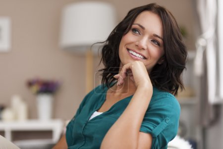 Photo for She looks relaxed in her home - woman in interior - Royalty Free Image