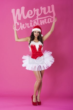 Girl holding  Merry Christmas for everyone sign