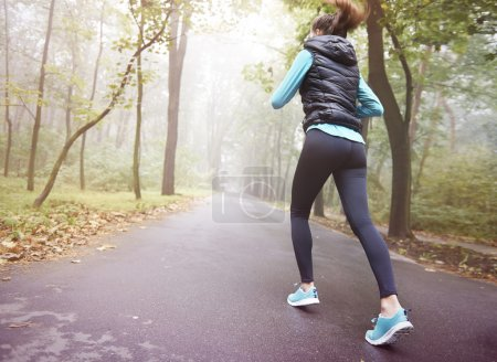 Photo for Young woman running in the morning park - Royalty Free Image